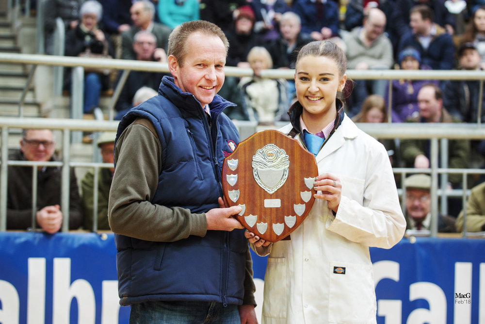 Ellie Sutherland receives the New Trend Trophy – Stirling February Bull Sales