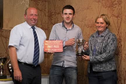 Andrew Clarke from Northern Ireland was the overall winner of the British Simmental Cattle Society's national stockjudging finals, held at Fermanagh County Show. He was congratulated by society president Iain Green, and Phylis Glasgow, wife of the NI Club chairman