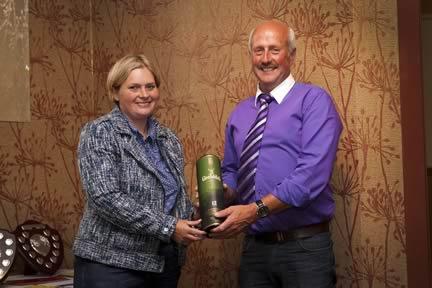 NI Club chairman Nigel Glasgow receives a token of appreciation from YMA co-ordinator Bridget Borlase.