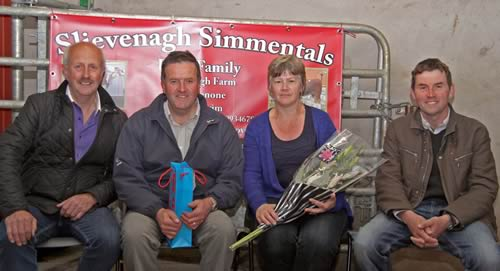 Hosts Robin and Darla Boyd, Slievenagh Herd, Portglenone, receive a token of the club's appreciation from Nigel Glasgow, left, chairman; and master judge, John Moore, Beragh.