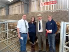 Clive and Harry Houldey receiving their prize for best pen of four heifers from Hilary Bennie & Tom Henderson.