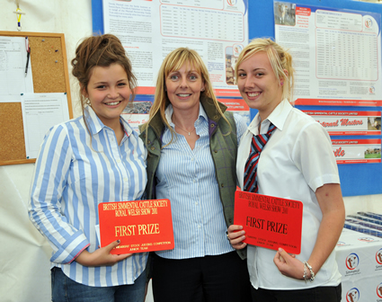 Hannah Wood and Hannah Shaw receive 1st Prize for Junior Team, presented by Sponsor Stephanie Denny from the Farmers Guardian