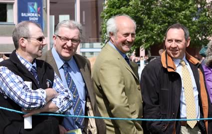Keeping an eye on the Simmental judging at Balmoral Show are Robert MacGregor, Perth; Neil Shand, general secretary, British Simmental Cattle Society; Nigel Glasgow, vice-chairman, and Pat Kelly, chairman, NI Simmental Cattle Breeders' Club