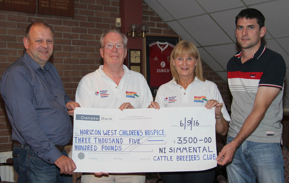 NI Simmental Club chairman Matthew Cunning, and vice chairman Conrad Fegan, presented a cheque for £3,500 to John Graham and Yvonne Bowles, from the Horizon West Children's Hospice in Killadeas.