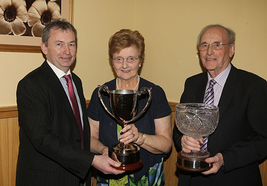 Andrew Tecey, Danske Bank, presents the Male of the Year Award to Raymond and Joan Porter, Omagh.