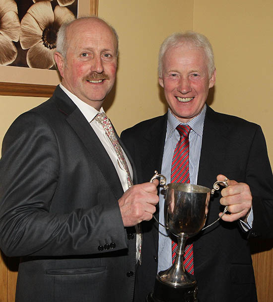 NI Simmental Cattle Breeders' Club chairman Nigel Glasgow, presents the Betty Walker Memorial Trophy for Club Member of the Year to treasurer Leslie Weatherup, Ballyclare.
