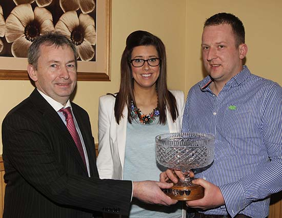 Jonny and Julie Hazelton, Dungannon, receive the award for the Reserve Male of the Year from sponsor Andrew Tecey, Danske Bank.