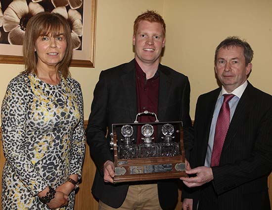 Mrs Phyllis Glasgow and Andrew Tecey, Danske Bank, congratulate Christopher Weatherup, Ballyclare, on his success at last year's Balmoral Show.