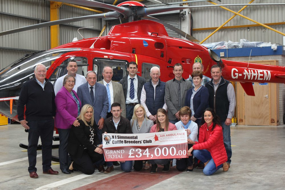 Office bearers and committee members of the NI Simmental Cattle Breeders' Club recently visited the headquarters of Air Ambulance Northern Ireland to present a cheque for £34,000. Included are AANI trustee Rodney Connor, and the charity's head of fundraising Kerry Anderson.