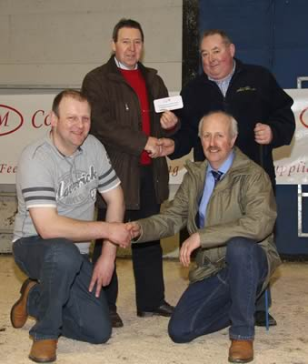 Pat Kelly, chairman, NI Simmental Cattle Breeders' Club, and vice-chairman Nigel Glasgow, receive a sponsorship cheque for the commercial section of the spring sale from John Connon and Matthew Cunning, Connon General Merchants